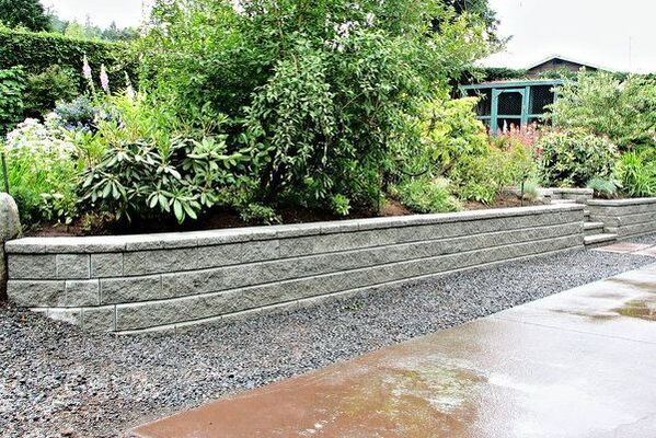 Concrete block landscape and soil retaining wall