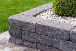 Grey stone landscape retaining wall on patio