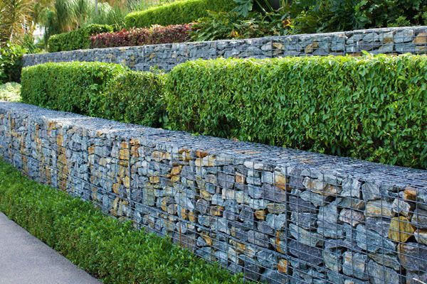 Rock and wire gabion multi tier retaining walls